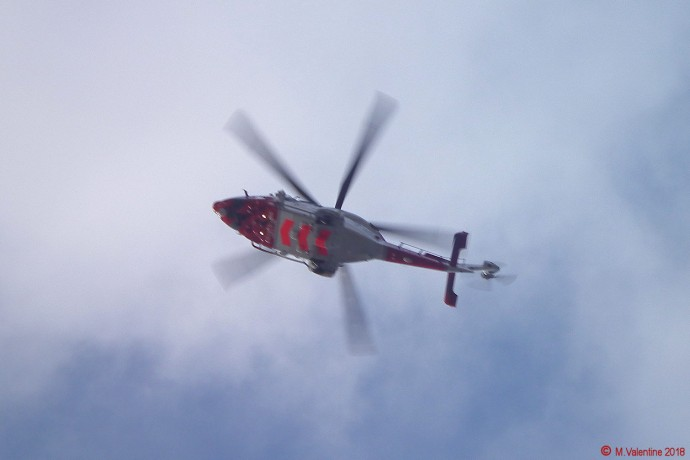 Coastguard helicopter leaving with casualty.