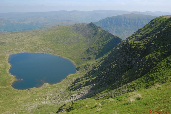 Striding Edge and Red Tarn from Helvellyn summit plateau.