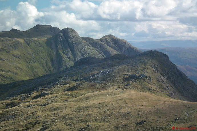 The view across Rossett Pike to Pike of Stickle and the Langdale Pikes.