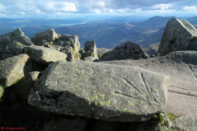 "The bench mark ""arrow"" at Bowfell summit."