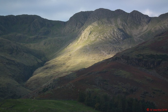 A shaft of morning sunshine hits Crinkle Crags.