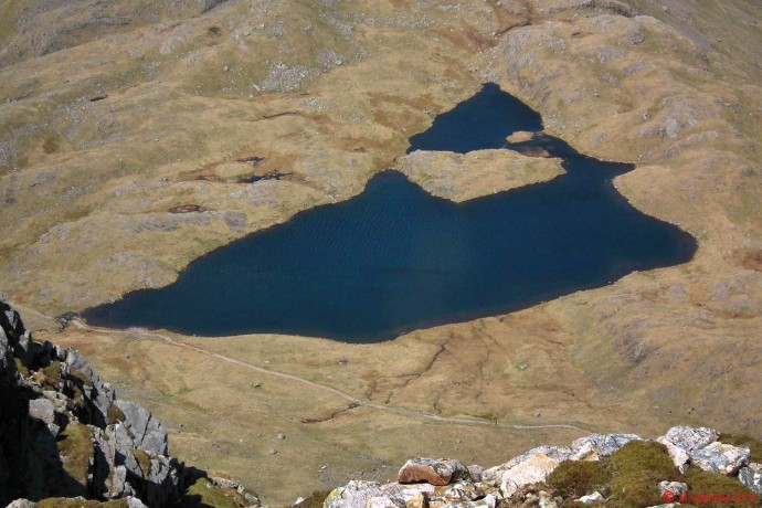 Looking down to Sprinkling Tarn from Great End summit plateau.