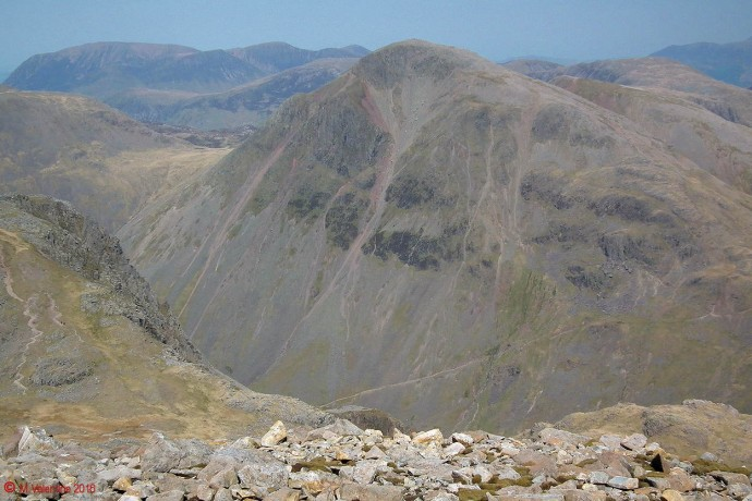 Great Gable dominating the view from Scafell Pike's summit slope.