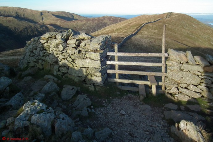 The Hole-In-The-Wall, with Birkhouse Moor beyond.